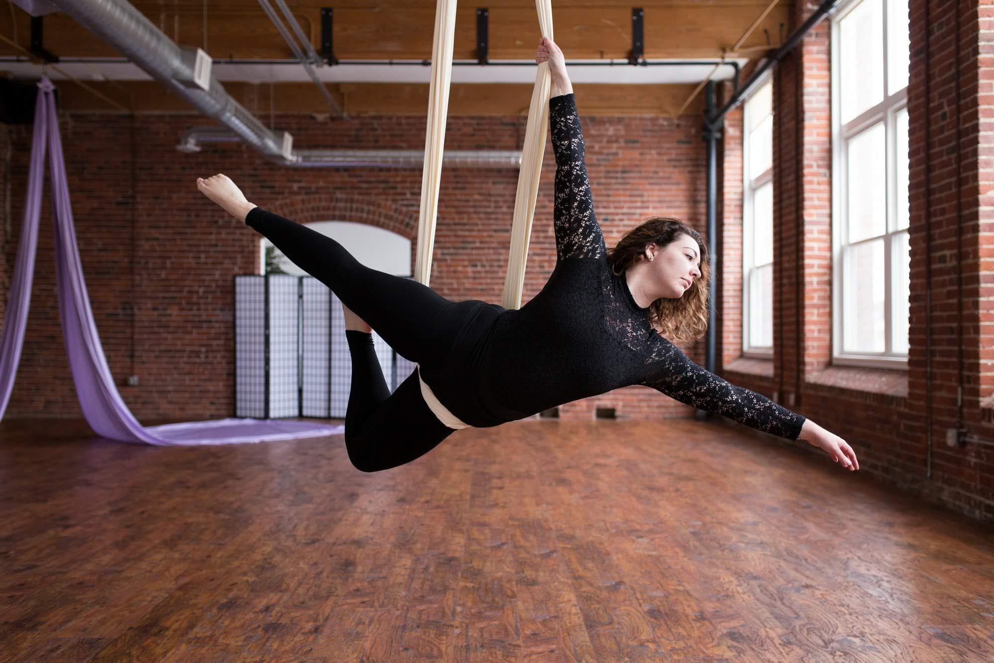 Aerial yoga studio fitness circus silks studio class classes manchester nh new hampshire karlene linxweiler best of nh